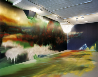 Katharina Grosse, If music no good I no dance, Infinite Logic Conference, 2004, acrylic on wall and objects, 388 x 2500 x 820 cm, Magasin 3 Stockholm Konsthall, Stockholm, photo: Mattias Givell, ©Magasin 3 Stockholm Konsthall/Mattias Givell
