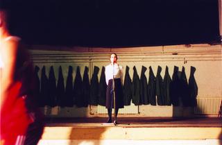 Maja Bajevic, Avanti Popolo, Maja Bajevic, La vie est belle, 2001, performance / photographs. Exhibition view: Café, Theatre, Art Depot, Sarajevo Winter Festival, CDA, Sarajevo, Bosnia and Herzegovina (Curator Jusuf Hadzifejzovic), 2001.  Photo documentation: Dejan Vekic