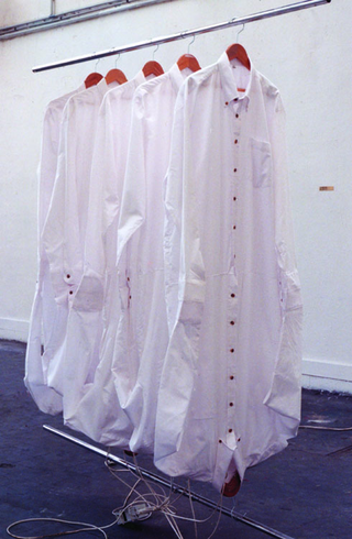Maja Bajevic, Avanti Popolo, Maja Bajevic, SCH, 1995, installation, shirts, hangers, clothes rack, light bulbs, sound.