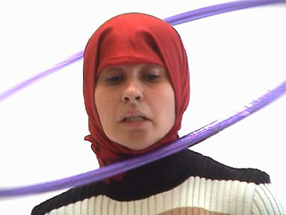 """As soon as possible. Performance loop. The Class of Marina Abramovic - Braunschweig School of Art, Nezaket Ekici, """"Hullabelly"""".  Nezaket Ekici artistic ideas are based from every day live situations, social art, cultural atmospheres. The Performances of her are expressed in using the body alone, as part of the installatians and within the context of an audience. The subjects: deal with are time, movment, space, material, body, action/interaction.  """"Hullabelly"""" is a performance and a installation, which tries to connect by his simplicity Cultural differences of two cultures and bring in a new context. By the choice of the elements of eastern belly dance music and Hula-hoop the viewer sees an approach of islamic tradition and today western culture. A piece of freedom thought is moved therefore in the Performance."""