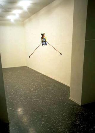 Maurizio Cattelan, Senza titolo, 1993 (Untitled) Teddy bear, thread, motor misura ambientale Courtesy:Galleria Massimo De Carlo, Milano