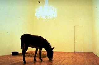 Maurizio Cattelan, Warning! Enter at your risk. Do not touch, do not feed, no smoking, no photographs, no dogs Thank you, 1994 Donkey and chandelier dimensioni reali Daniel Newburg Gallery, New York Foto di Lina Bertucci