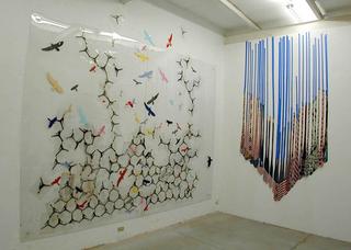 Nic Hess, The doors and a Window (Are We All American?), Left: Birds, 2003, installazione site-specific: pellicola autoadesiva, fotocopia su lucido, plexiglass. Right: G30, 2003, 30 cravatte, nastro adesivo Foto di Roberto Marossi.