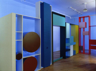 Tobias Rehberger, Luci diffuse, Jack Lemon's legs and other libraries, 2000, MDF, paint, televisions, VCR